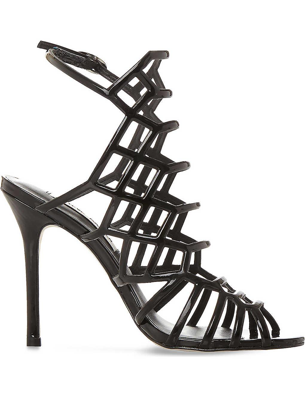 68de0954c8b STEVE MADDEN - Slithur caged patent sandals | Selfridges.com