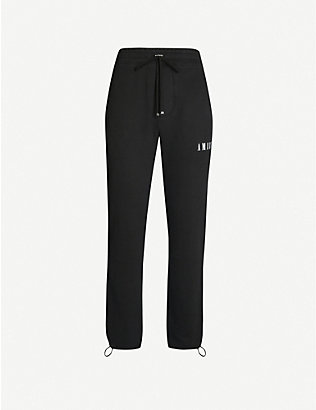 AMIRI: Dagger tapered cotton-jersey jogging bottoms