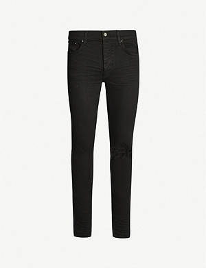 AMIRI Ripped skinny stretch-denim jeans