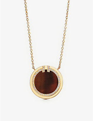 TIFFANY & CO: Tiffany T Circle 18ct gold, tiger's eye and 0.05ct diamond pendant necklace