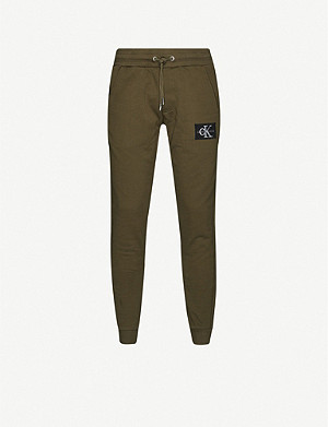 CK JEANS Monogram patch tapered cotton-jersey jogging bottoms