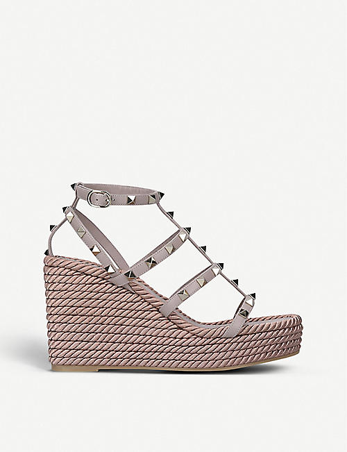 VALENTINO GARAVANI: Rockstud leather wedge sandals