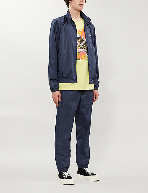 STUSSY Brand-embroidered relaxed-fit checked shell trousers