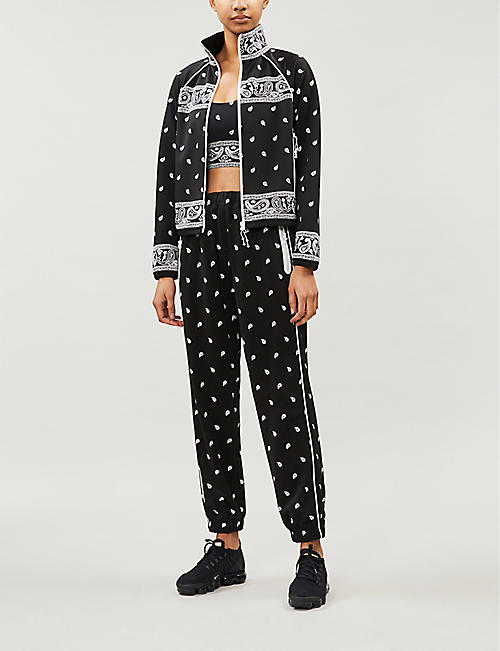ADAM SELMAN SPORT Graphic-print tapered stretch-jersey trousers