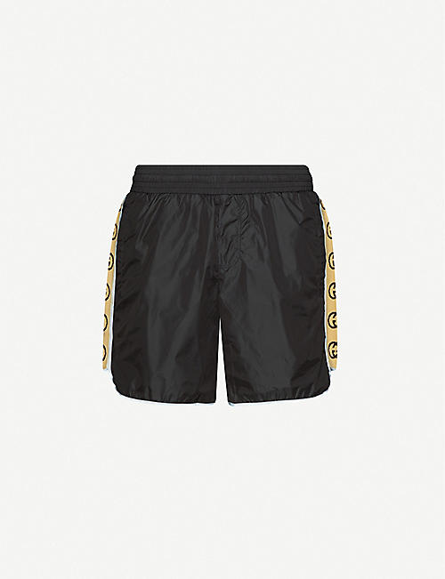 GUCCI: Logo-tape relaxed-fit swim shorts