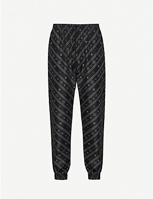 FENDI: Drawstring-waistband brand-print shell trousers