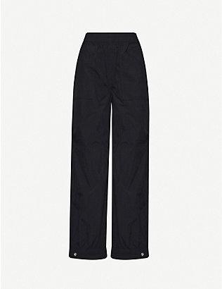 GANNI: Tapered mid-rise shell jogging bottoms