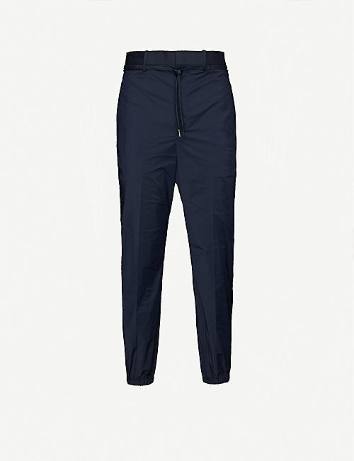NEIL BARRETT Slim tapered shell jogging bottoms