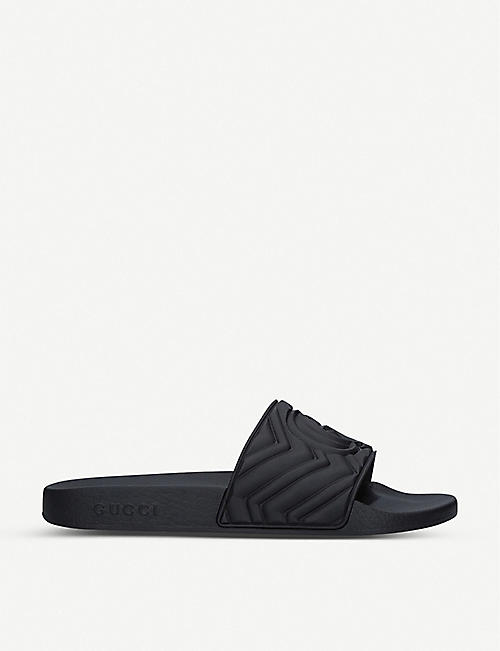 GUCCI Pursuit logo-embossed rubber sliders