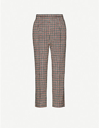 KHAITE: Bridget check-print tapered high-rise wool-blend trousers