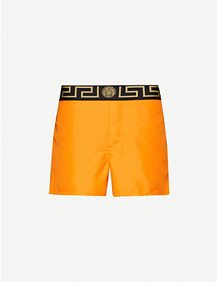 VERSACE: Solid logo-trim swim shorts