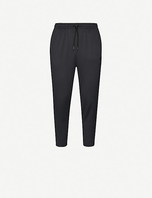 UNDER ARMOUR Unstoppable woven jogging bottoms