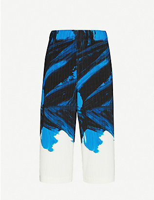 HOMME PLISSE ISSEY MIYAKE: Paint-print pleated woven trousers