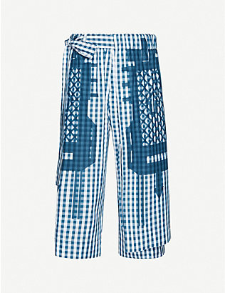 CRAIG GREEN: Graphic-print wide cotton-poplin trousers