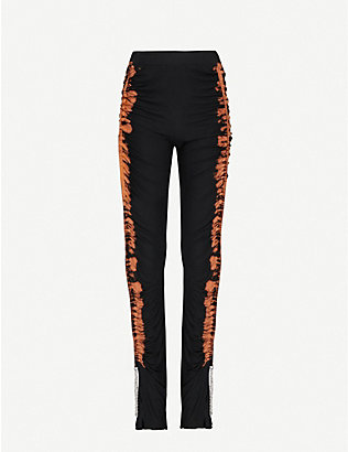 LEO: Tie-dye pattern slim-leg high-rise stretch-knitted trousers