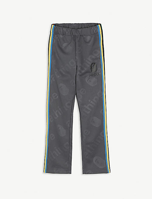 A BATHING APE: Striped woven jogging bottoms 6-8 years