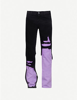 RAF SIMONS: Distressed tapered jeans