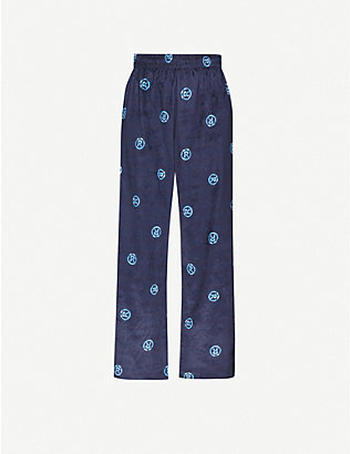 MARTINE ROSE: Graphic-print wide-leg high-rise cotton-blend trousers