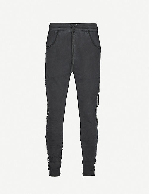 ALCHEMIST: Printed-tape cotton-jersey jogging bottoms