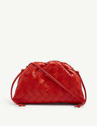 BOTTEGA VENETA: The Pouch Intrecciato mini leather clutch bag