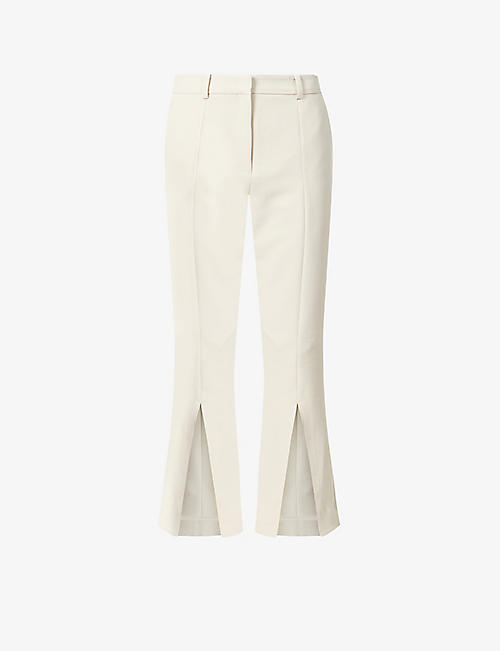 ROKH: Kick-split high-rise woven trousers