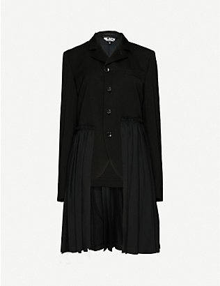 BLACK COMME DES GARCON: Pleated-overlay peplum wool coat