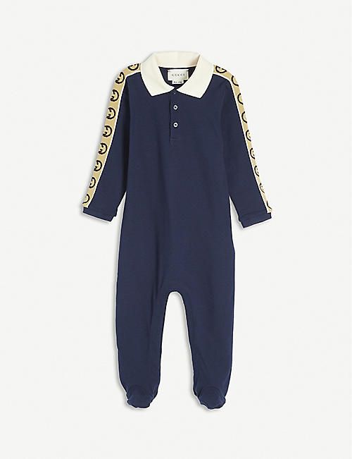GUCCI: Logo-tape cotton babygrow 3-24 months