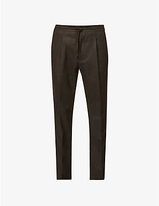 CORNELIANI: Drawstring-waistband tapered wool-flannel trousers
