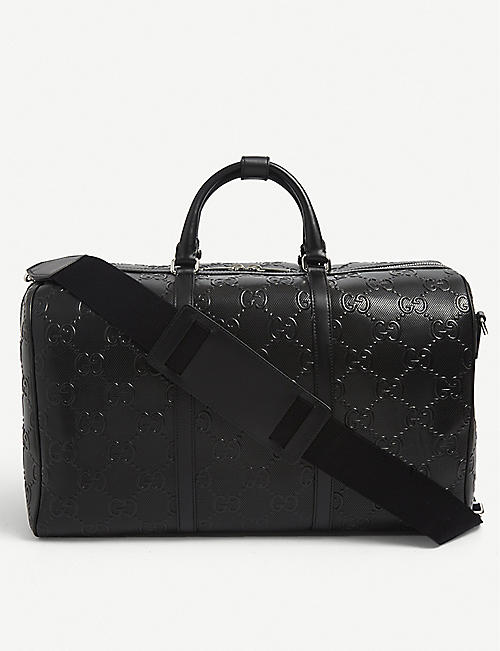 GUCCI: GG logo-embossed leather duffle bag