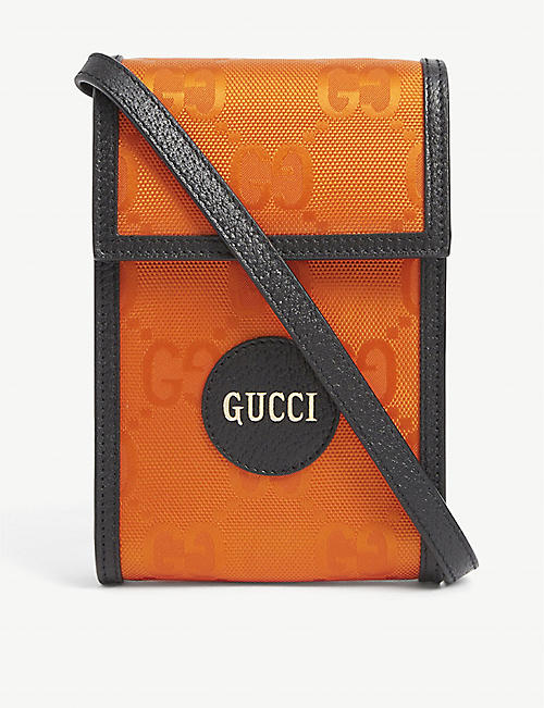 GUCCI: Gucci logo-embellished woven cross-body phone case
