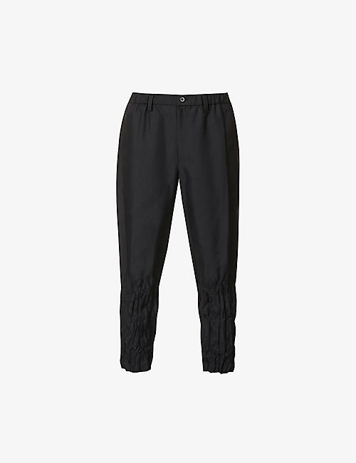 ISSEY MIYAKE: Twist Basics crinkled tapered crepe trousers