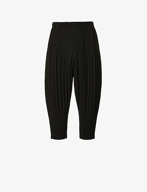HOMME PLISSE ISSEY MIYAKE: Pleated wide woven trousers