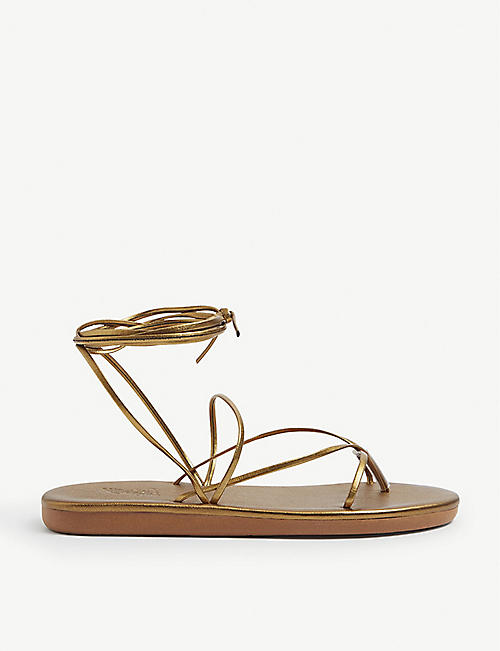 ANCIENT GREEK SANDALS: String metallic leather flip flops