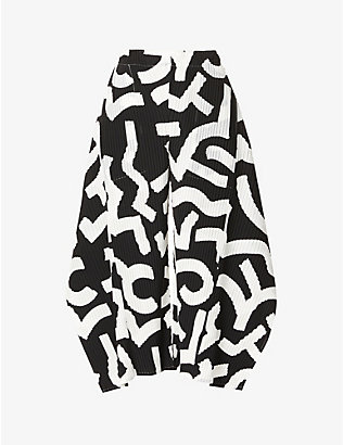 ISSEY MIYAKE: Graphic-print wide-leg high-rise woven trousers