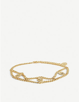 ALESSANDRA RICH: Lion charm embellished gold-tone chain belt