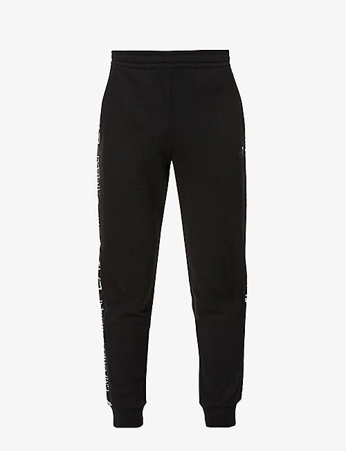EA7 ARMANI: Logo-print cotton-blend jersey jogging bottoms