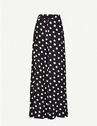 PAPER LONDON: Kelly polka dot-print high-rise satin trousers