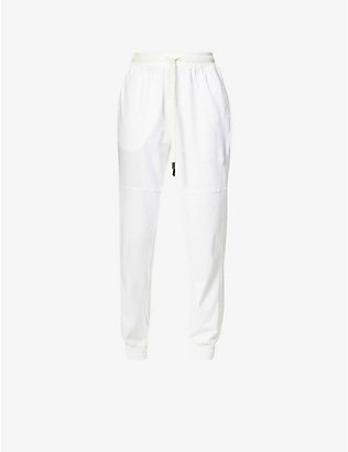 BASSIKE: Tapered high-rise organic cotton jogging bottoms