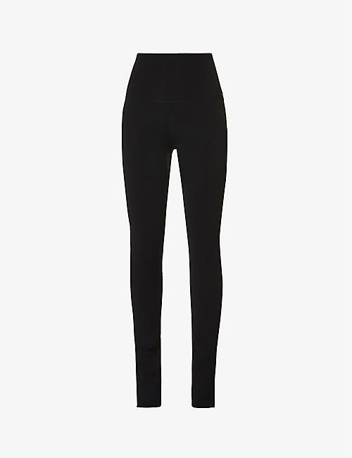 KHAITE: Roonie split-cuff skinny high-rise stretch-knit trousers