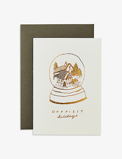 KATIE LEAMON: Snow Globe Cabins greeting card 14.8 x 10.4cm