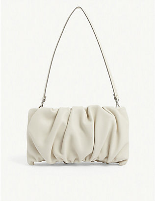 STAUD: Bean ruched leather clutch