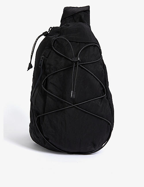 CP COMPANY: Lens-embellished woven cross-body bag