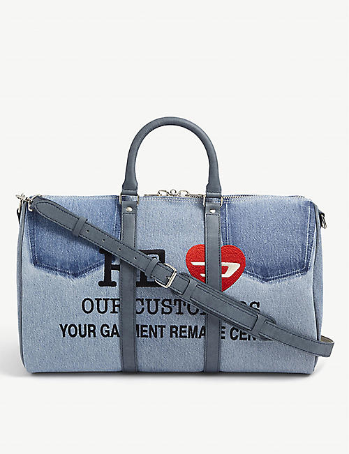 READYMADE: Slogan-embroidered denim holdall