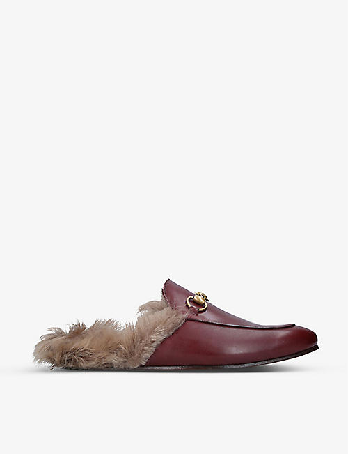 GUCCI: Princetown leather fur lined mules