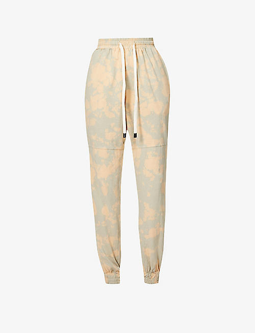 BASSIKE: Motley tie-dyed organic-cotton jersey jogging bottoms