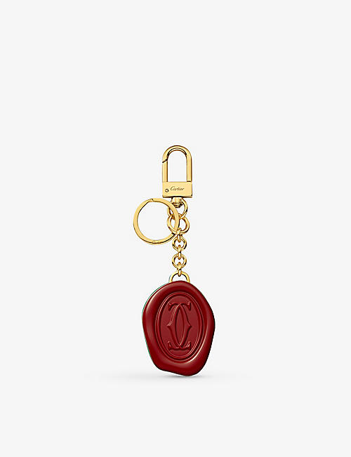 CARTIER: Diabolo de Cartier gold-finished keyring with wax seal motif