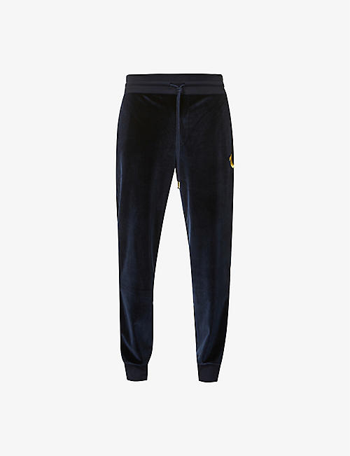 TRUE RELIGION: High-rise tapered-fit velvet jogging bottoms