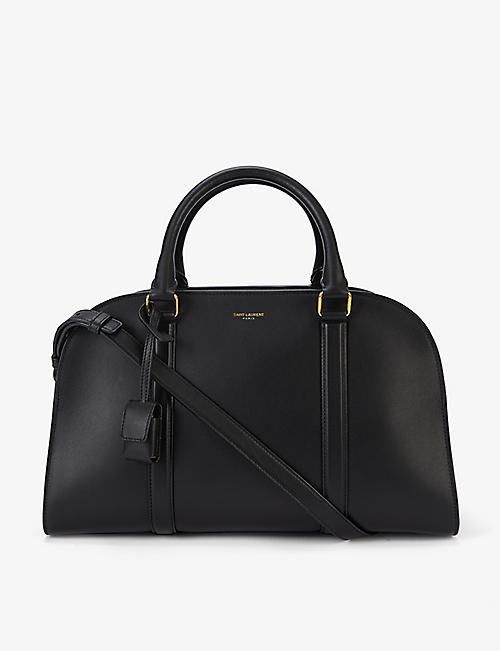 SAINT LAURENT: Lock branded leather bowling bag