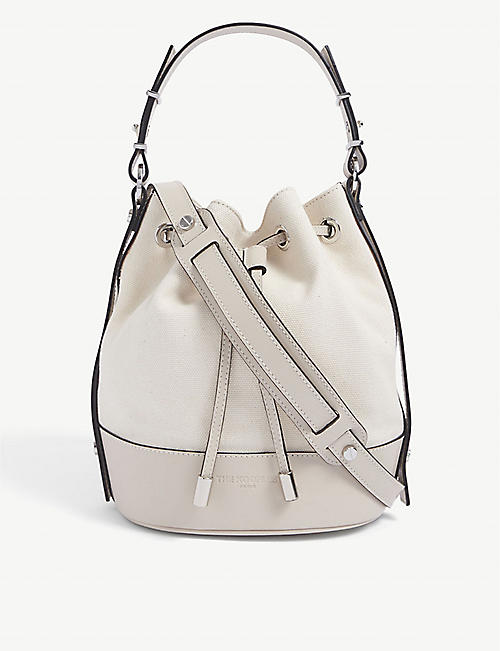 THE KOOPLES: Tina small brand-embossed leather bucket bag