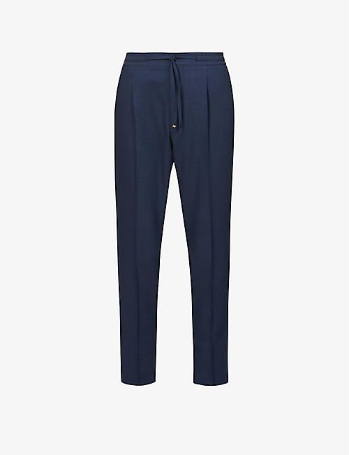CORNELIANI: Tapered relaxed-fit stretch-wool trousers